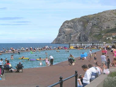The popular paddling pool in Graig y Don  on the north shore Llandudno